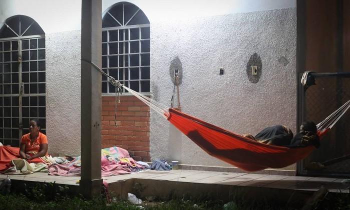 Migrantes venezuelanos nas ruas de Paracaima (RO).